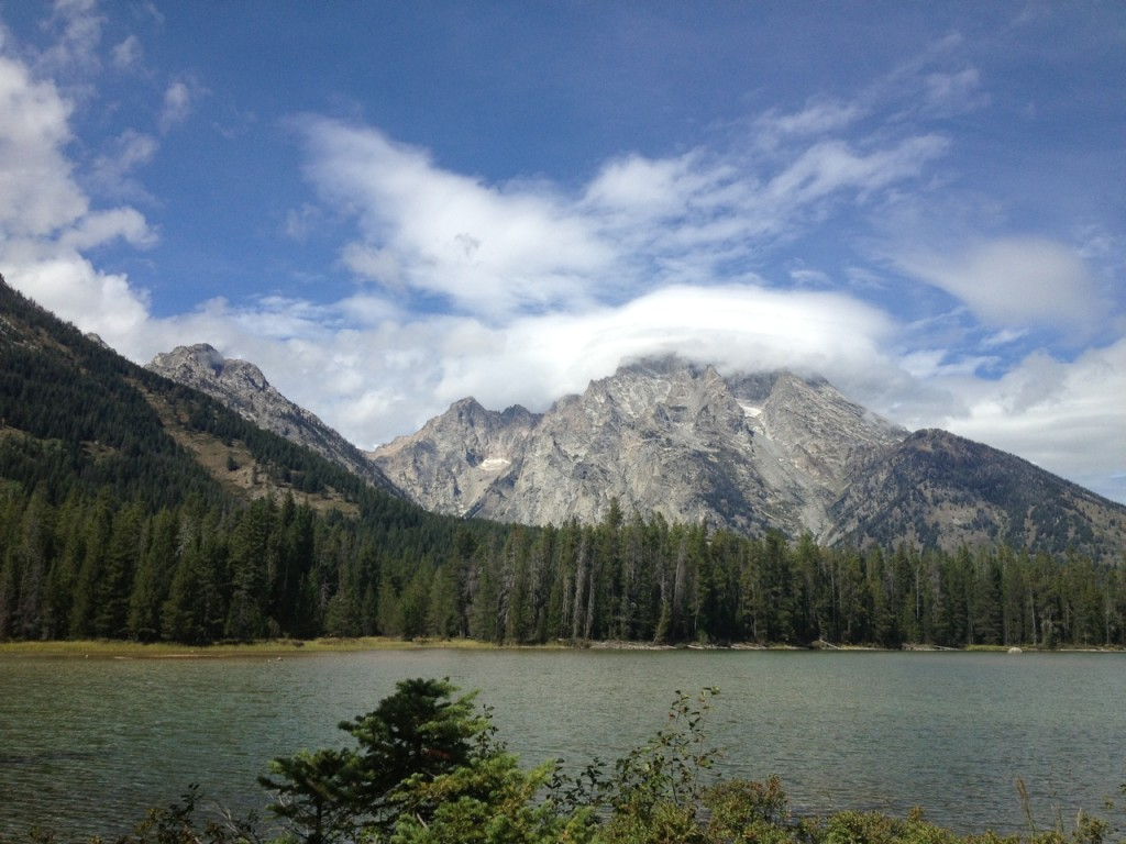 string lake with mount moran covered in clouds